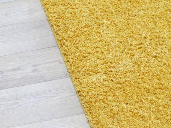 bodenfachmarkt d sseldorf hochflor teppich shaggy gelb mit einfassung. Black Bedroom Furniture Sets. Home Design Ideas